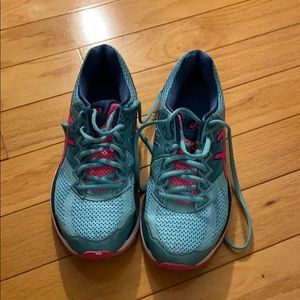 Blue and pink running shoes